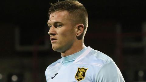 Alan Lithgow was banned when he played against Irish League side Crusaders in Belfast
