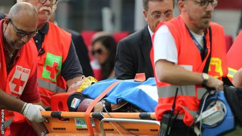 AC Milan defender Luca Antonelli on a stretcher