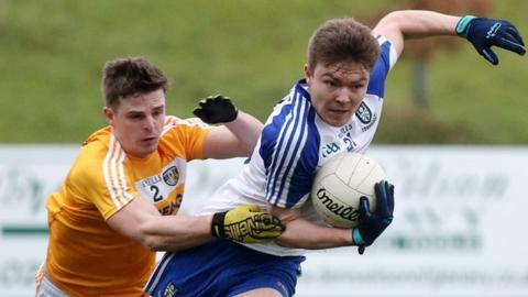 Antrim's Conor Hamill attempts to keep pace with Monaghan's Barry McGinn