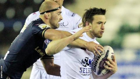 Widnes's Joe Mellor tries to get away from a tackle