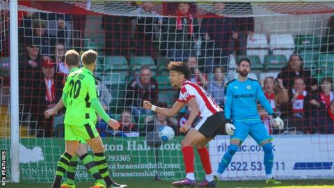 Marcus Kelly's own goal puts Lincoln ahead against Forest Green