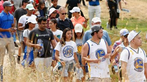 Crowds of Golden State Warriors fans followed Curry around the course