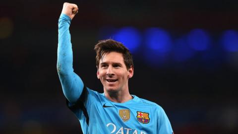 Lionel Messi raises his fist in the air in celebration