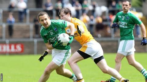 Daniel Kille shields the ball from Justin Crozier at Brewster Park