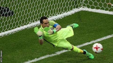 Bravo saves three penalties to send Chile into Confederations Cup final