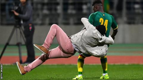 Senegal player Lamine Gassama was grabbed by a fan during the incident