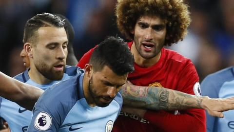 Marouane Fellaini tries to talk to Sergio Aguero after the headbutt