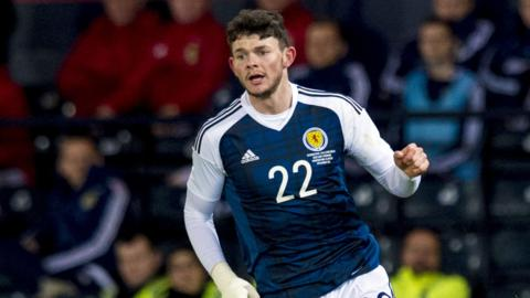 Oliver Burke in action for Scotland against Denmark in March