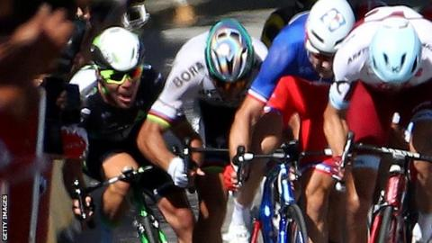 Mark Cavendish (left) hits the barriers after tangling with Peter Sagan