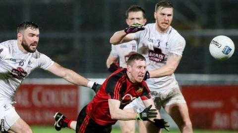 Kildare pair Johnny Byrne and Fergal Conway move in to challenge Mourne forward Joe Murphy