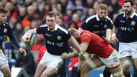 Scotland's Stuart Hogg tackled