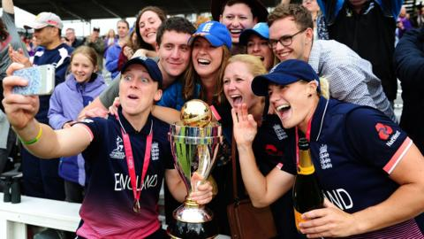 Heather Knight and Katherine Brunt celebrate with England fans
