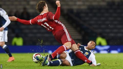 Denmark's Erik Sviatchenko is tackled by Scotland's Liam Bridcutt