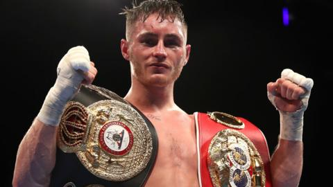 Ryan Burnett proudbly display his two world belts after his victory over Zhanat Zhakiyano