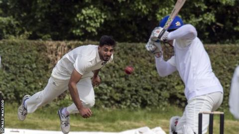 Scotland's Safyaan Sharif bowls against Namibia