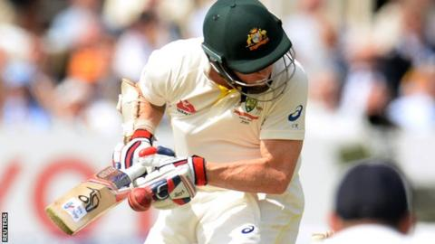 Chris Rogers is hit on the helmet