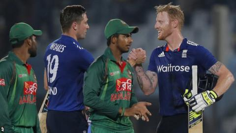 Chris Woakes and Ben Stokes celebrate England's victory