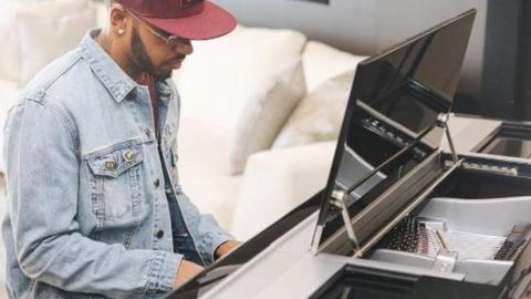 Lewis Hamilton playing his piano