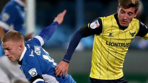 "Danny M. Rowe and Oxford United""s Joe Rothwell"