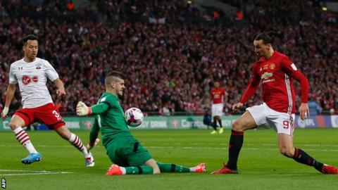 Southampton keeper Fraser Forster denies Manchester United striker Zlatan Ibrahimovic during the EFL Cup final at Wembley
