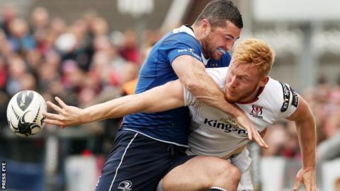 Ulster wing Rory Scholes gets his pass away despite a strong challenge from Leinster's Rob Kearney