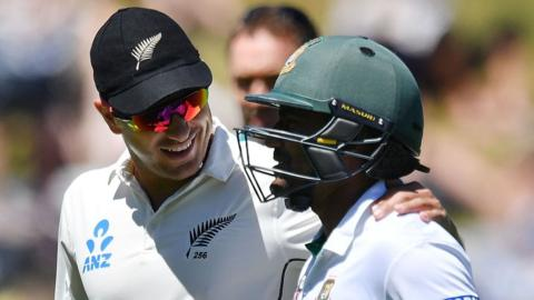 New Zealand's Neil Wagner (L) walks from the field with Bangladesh's Imrul Kayes