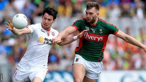 Mattie Donnelly in action against Aidan O'Shea in Saturday's first semi-final at Croke Park