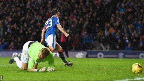 Jason Holt celebrates after scoring for Rangers against Hibernian