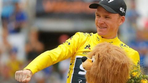 Chris Froome celebrates on the podium at the end of stage 20