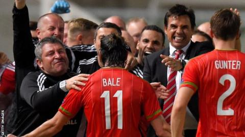 Gareth Bale and the Wales coaches celebrate
