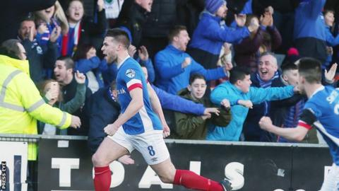 Stephen Lowry runs away in delight after scoring Linfield's opener against Crusaders