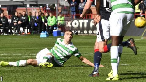 Jozo Simunovic steers the ball towards goal for Celtic's opener