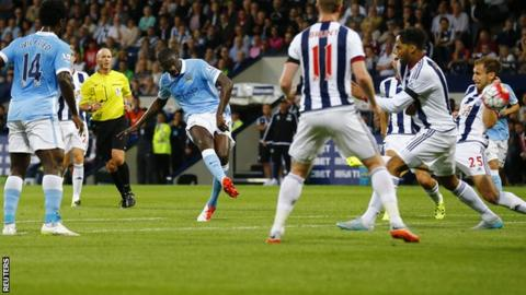 Manchester City midfielder Yaya Toure scores against West Brom