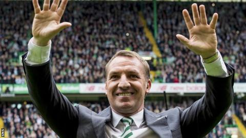 Celtic manager Brendan Rodgers celebrates with supporters