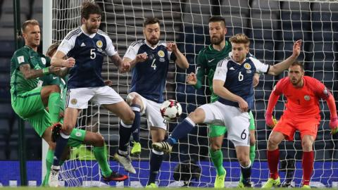 Scotland's Stuart Armstrong challenges for the ball against Slovenia