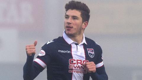 Chris Routis celebrates scoring the opening goal for Ross County