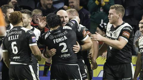 Gareth Ellis is mobbed by jubilant Hull FC team-mates