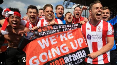 Lincoln City player celebrate promotion