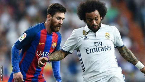 Lionel Messi of Barcelona and Real Madrid's Marcelo