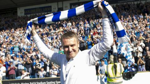 Lee Clark celebrates with a Kilmarnock scarf after their play-off victory