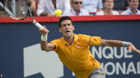 Novak Djokovic plays a forehand