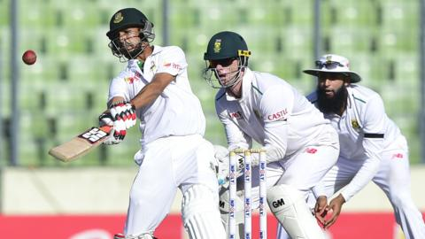 Bangladesh's Nasir Hossain with South Africa's Dane Vilas and Hashim Amla