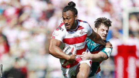 Leigh's Atelea Vea tries to power clear of Hull KR's Jordan Abdull