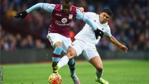 Aston Villa forward Jordan Ayew competes with Swansea's Jefferson Montero