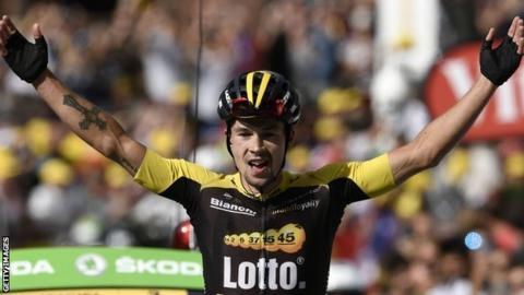 Primoz Roglic celebrates winning stage 17