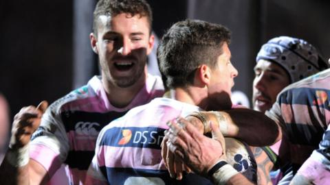 Lloyd Williams is congratulated after scoring a late try for Blues