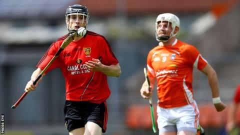 Down's Steven Dineen and Declan Coulter of Armagh in action at the Athletic Grounds