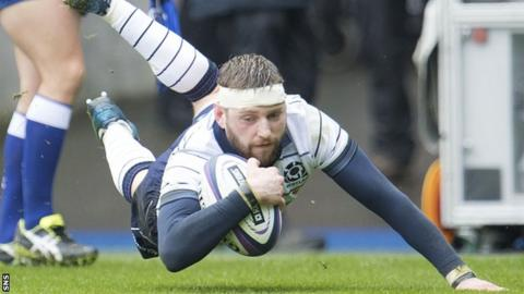 Finn Russell bursts through to score Scotland's first try
