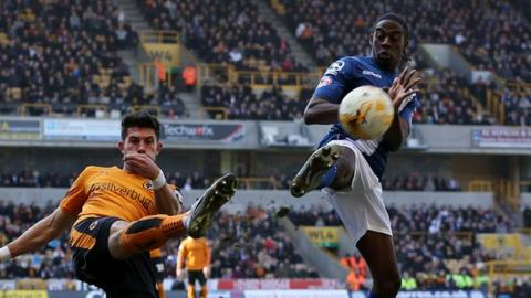 Wolves captain Danny Batth clears under pressure from Clayton Donaldson