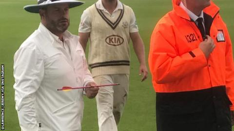 Cricket match suspended at The Oval after crossbow bolt lands on pitch